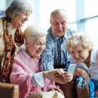 Group of seniors using mobile phone